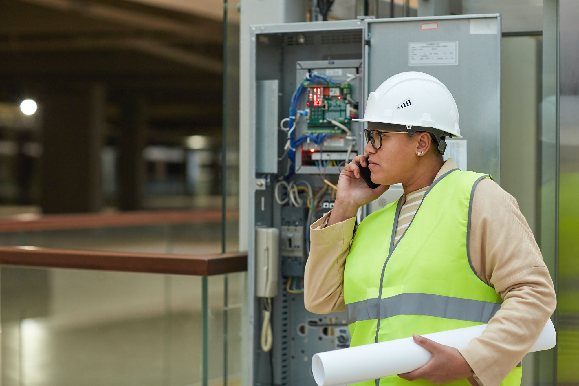Female Engineer Inspecting Electric Systems